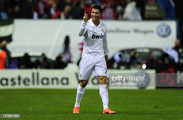 Real Madrid's Portuguese forward Cristiano Ronaldo celebrates after scoring during the Spanish league football match Atletico Madrid against Real...