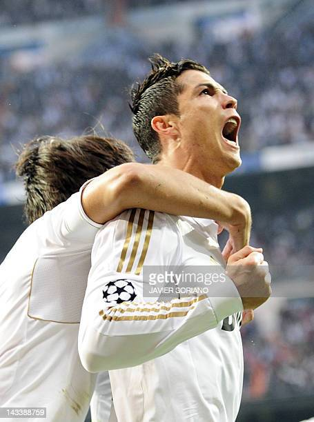 Real Madrid's Portuguese forward Cristiano Ronaldo celebrates after scoring during the UEFA Champions League second leg semifinal football match Real...
