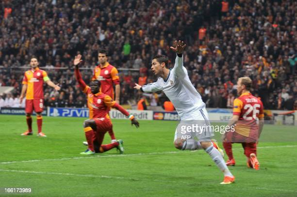 Real Madrid's Portuguese forward Cristiano Ronaldo celebrates after scoring the first goal of his team during the UEFA Champions League quarterfinal...