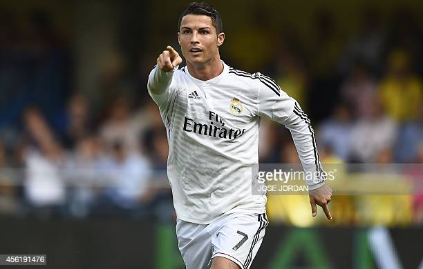 Real Madrid's Portuguese forward Cristiano Ronaldo celebrates after scoring during the Spanish league football match Villarreal CF vs Real Madrid CF...