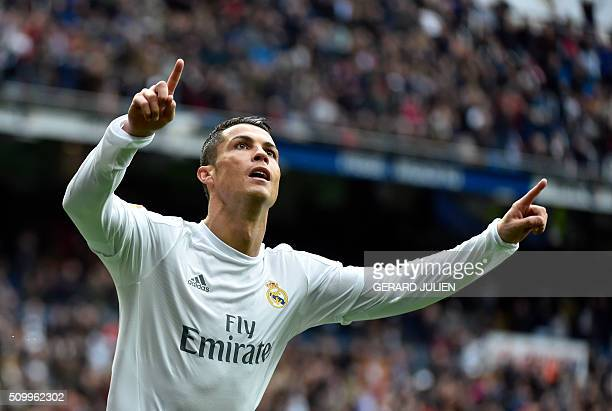 Real Madrid's Portuguese forward Cristiano Ronaldo celebrates after scoring during the Spanish league football match Real Madrid CF vs Athletic Club...