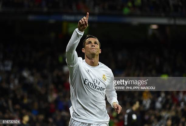Real Madrid's Portuguese forward Cristiano Ronaldo celebrates after scoring during the Spanish league football match Real Madrid CF vs Sevilla FC at...