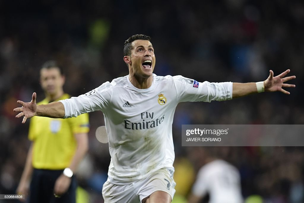 TOPSHOT - Real Madrid's Portuguese forward Cristiano Ronaldo celebrates after scoring his third goal during the Champions League quarter-final second leg football match Real Madrid vs Wolfsburg at the Santiago Bernabeu stadium in Madrid on April 12, 2016. / AFP / JAVIER