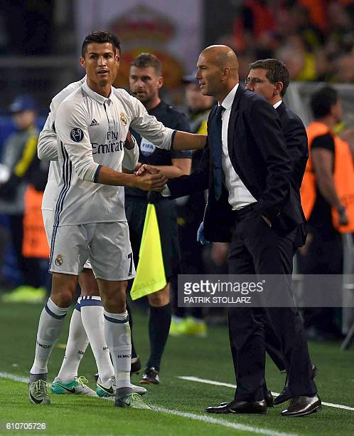 Real Madrid's Portuguese forward Cristiano Ronaldo celebrates after his goal with Real Madrid's French coach Zinedine Zidane during the UEFA...