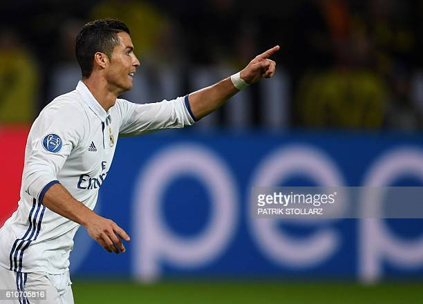 Real Madrid's Portuguese forward Cristiano Ronaldo celebrates after his goal during the UEFA Champions League first leg football match between...