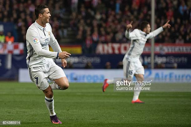 Real Madrid's Portuguese forward Cristiano Ronaldo celebrates after scoring during the Spanish league football match Club Atletico de Madrid vs Real...