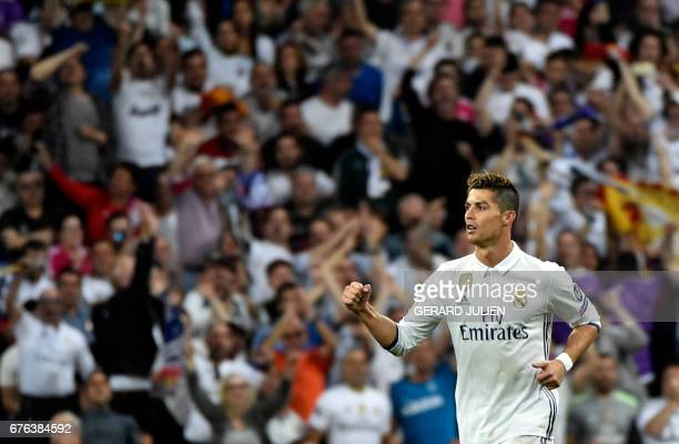 Real Madrid's Portuguese forward Cristiano Ronaldo celebrates after scoring his second goal during the UEFA Champions League semifinal first leg...