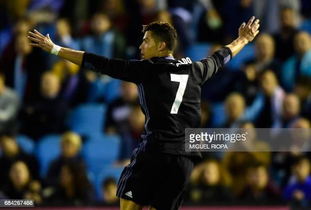 Real Madrid's Portuguese forward Cristiano Ronaldo celebrates after scoring his second goal during the Spanish league football match RC Celta de Vigo...