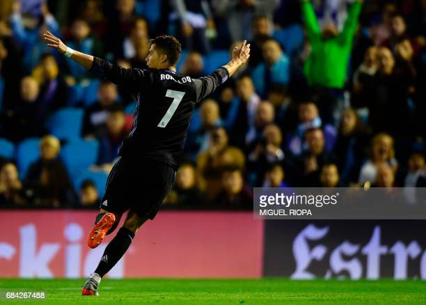 Real Madrid's Portuguese forward Cristiano Ronaldo celebrates after scoring his second goal during the Spanish league football match RC Celta de Vigo...