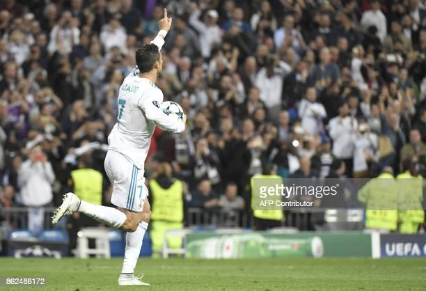 Real Madrid's Portuguese forward Cristiano Ronaldo celebrates after scoring during the UEFA Champions League group H football match Real Madrid CF vs...