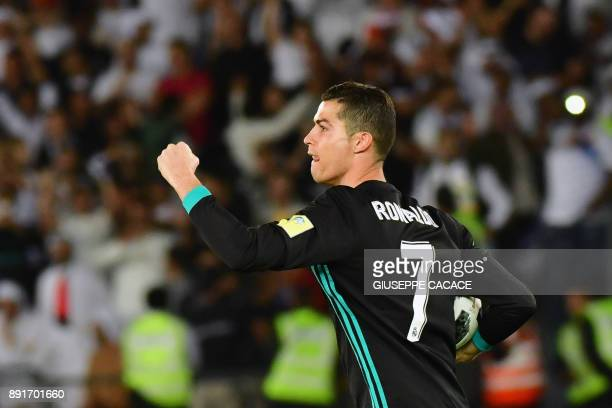 TOPSHOT Real Madrid's Portuguese forward Cristiano Ronaldo celebrates after scoring his team's equaliser during the FIFA Club World Cup semifinal...