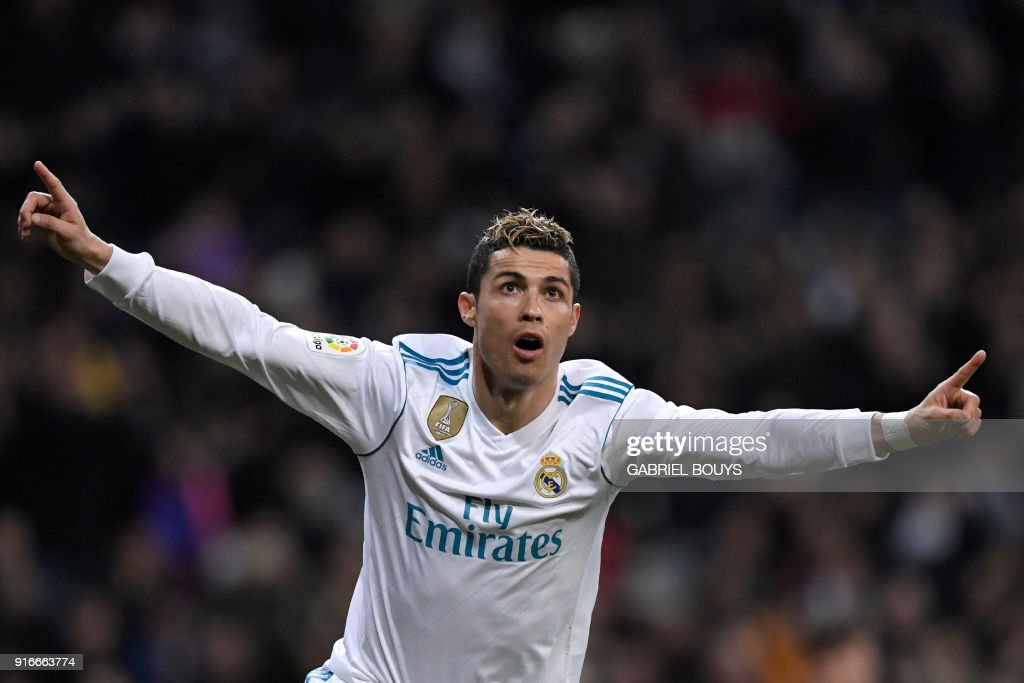Real Madrid's Portuguese forward Cristiano Ronaldo celebrates after scoring during the Spanish league football match between Real Madrid CF and Real Sociedad at the Santiago Bernabeu stadium in Madrid on February 10, 2018. /