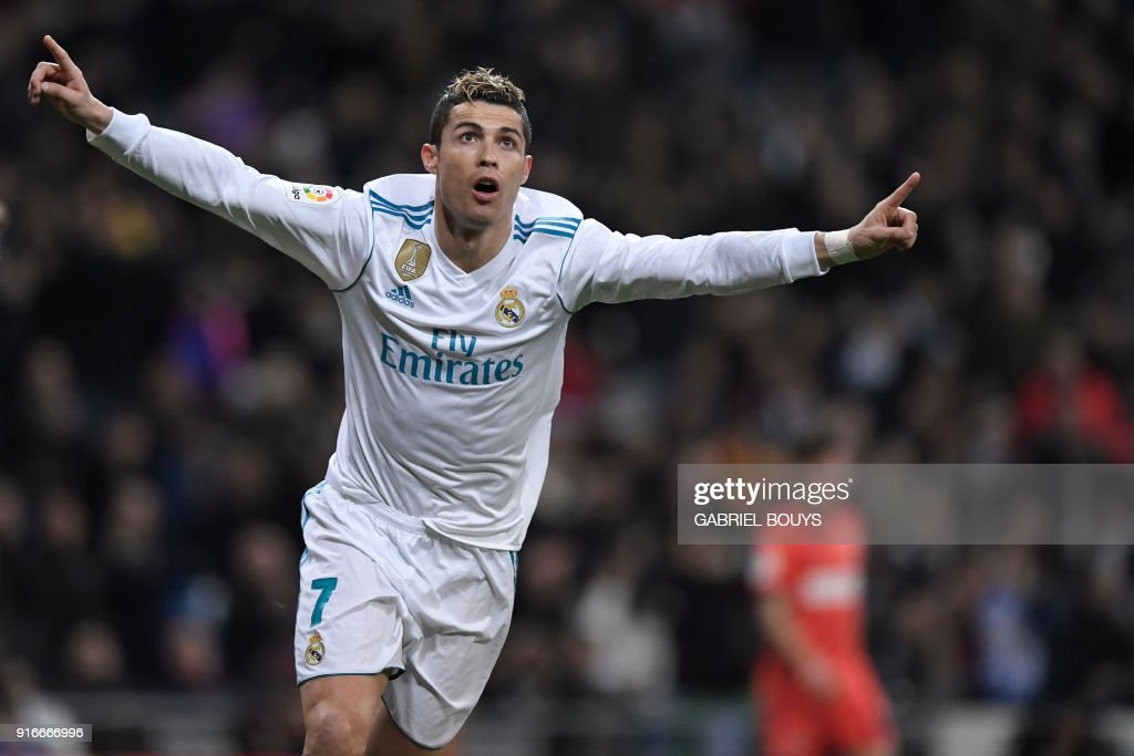 TOPSHOT - Real Madrid's Portuguese forward Cristiano Ronaldo celebrates after scoring during the Spanish league football match between Real Madrid CF and Real Sociedad at the Santiago Bernabeu stadium in Madrid on February 10, 2018. /
