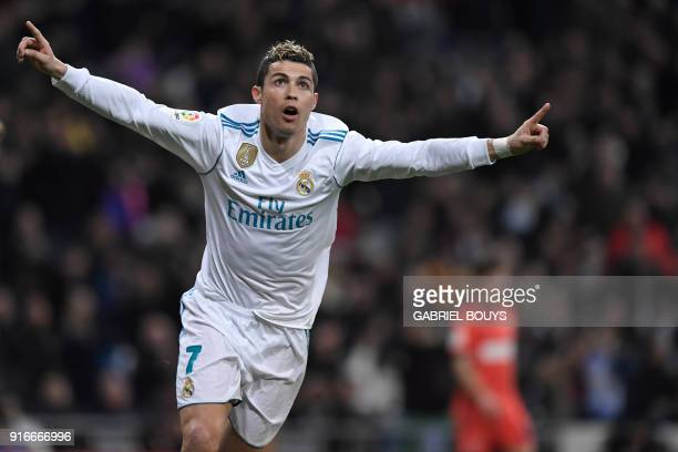 TOPSHOT Real Madrid's Portuguese forward Cristiano Ronaldo celebrates after scoring during the Spanish league football match between Real Madrid CF...