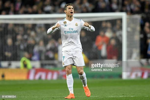 Real Madrid's Portuguese forward Cristiano Ronaldo celebrates after scoring during the UEFA Champions League round of sixteen first leg football...