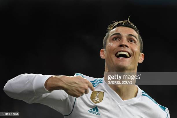 TOPSHOT Real Madrid's Portuguese forward Cristiano Ronaldo celebrates after scoring his second goal during the UEFA Champions League round of sixteen...