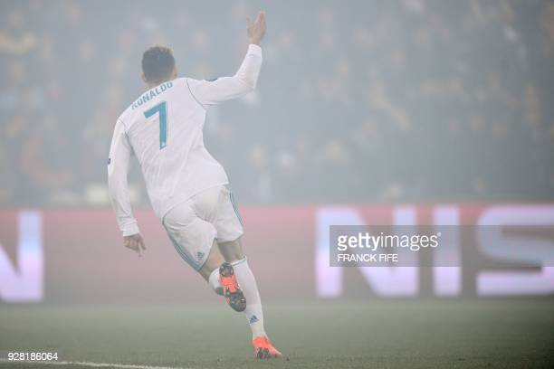 TOPSHOT Real Madrid's Portuguese forward Cristiano Ronaldo celebrates after scoring the opening goal during the UEFA Champions League round of 16...