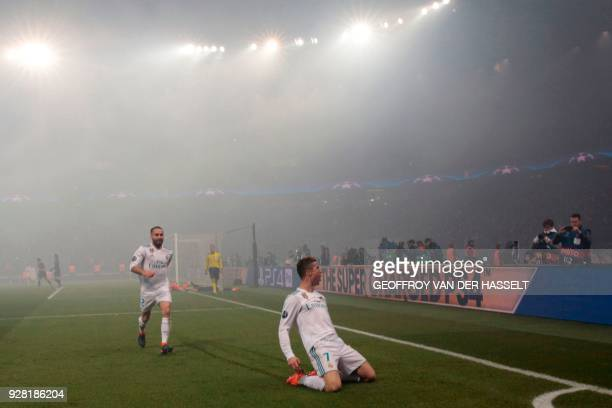 Real Madrid's Portuguese forward Cristiano Ronaldo celebrates after scoring the opening goal during the UEFA Champions League round of 16 second leg...