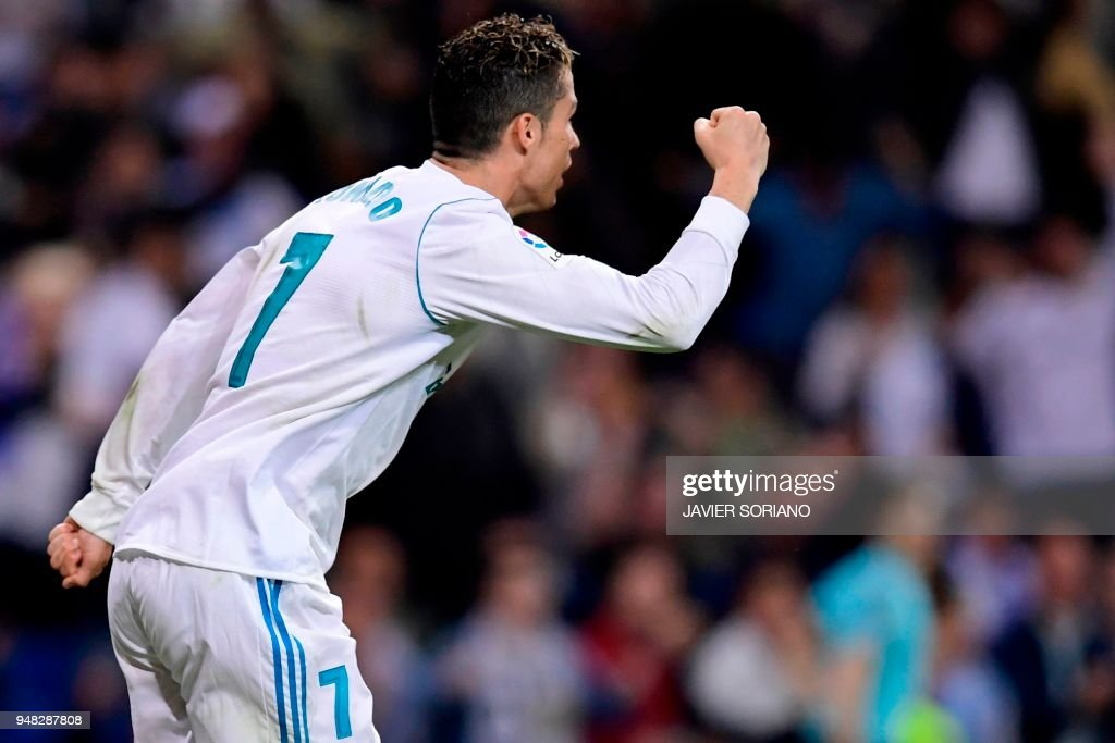 Real Madrid's Portuguese forward Cristiano Ronaldo celebrates after scoring during the Spanish league football match Real Madrid CF against Athletic Club Bilbao at the Santiago Bernabeu stadium in adrid on April 18, 2018. /