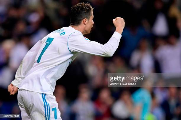 Real Madrid's Portuguese forward Cristiano Ronaldo celebrates after scoring during the Spanish league football match Real Madrid CF against Athletic...