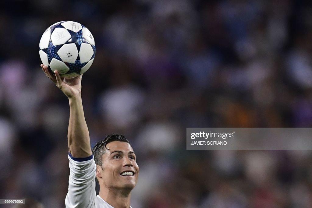 Real Madrid's Portuguese forward Cristiano Ronaldo celebrates during the UEFA Champions League quarter-final second leg football match Real Madrid vs FC Bayern Munich at the Santiago Bernabeu stadium in Madrid in Madrid on April 18, 2017. /