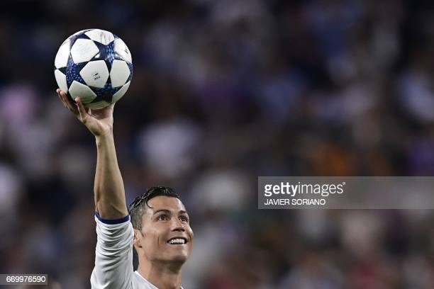 Real Madrid's Portuguese forward Cristiano Ronaldo celebrates during the UEFA Champions League quarterfinal second leg football match Real Madrid vs...