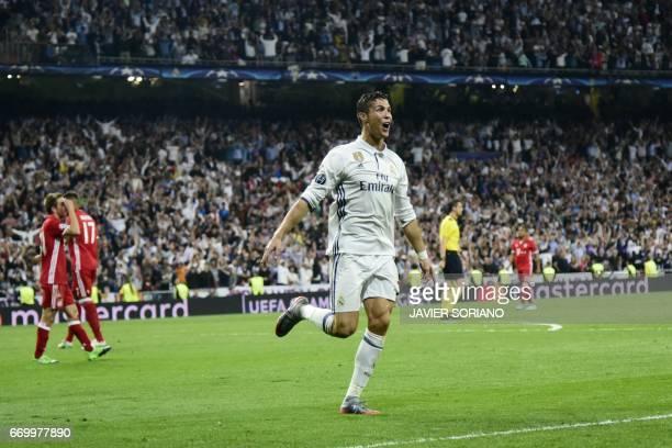 TOPSHOT Real Madrid's Portuguese forward Cristiano Ronaldo celebrates during the UEFA Champions League quarterfinal second leg football match Real...