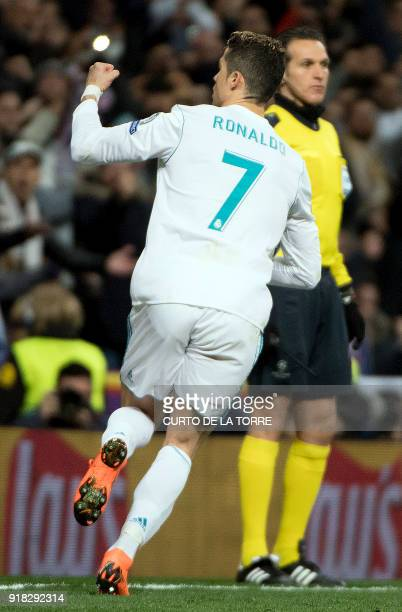Real Madrid's Portuguese forward Cristiano Ronaldo celebrates during the UEFA Champions League round of sixteen first leg football match Real Madrid...