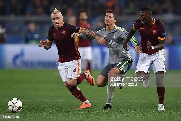Real Madrid's Portuguese forward Cristiano Ronaldo celebrates fights for the ball with Roma's midfielder from Belgium Radja Nainggolan and Roma's...