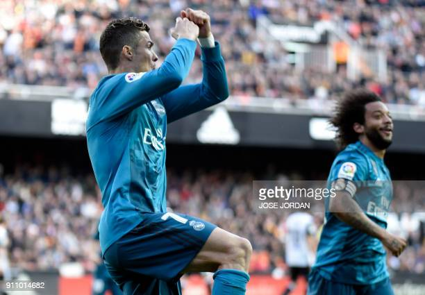 Real Madrid's Portuguese forward Cristiano Ronaldo celebrates his second goal following a penalty kick during the Spanish league football match...