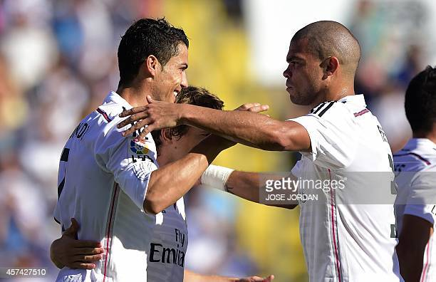 Real Madrid's Portuguese forward Cristiano Ronaldo celebrates his goal with Real Madrid's Portuguese defender Pepe during the Spanish league football...