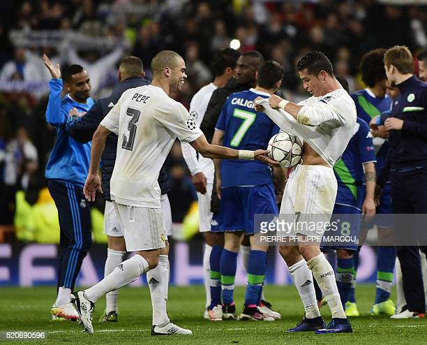 Real Madrid's Portuguese forward Cristiano Ronaldo celebrates his hat trick with Real Madrid's Portuguese defender Pepe during the Champions League...