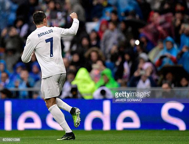 Real Madrid's Portuguese forward Cristiano Ronaldo celebrates his second goal during the Spanish league football match Real Madrid CF vs Real...