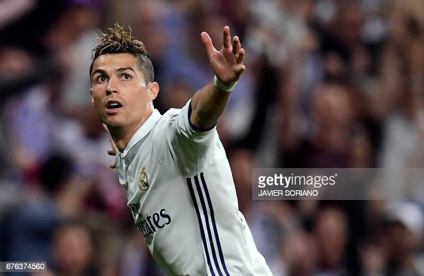 TOPSHOT Real Madrid's Portuguese forward Cristiano Ronaldo celebrates his second goal during the UEFA Champions League semifinal first leg football...