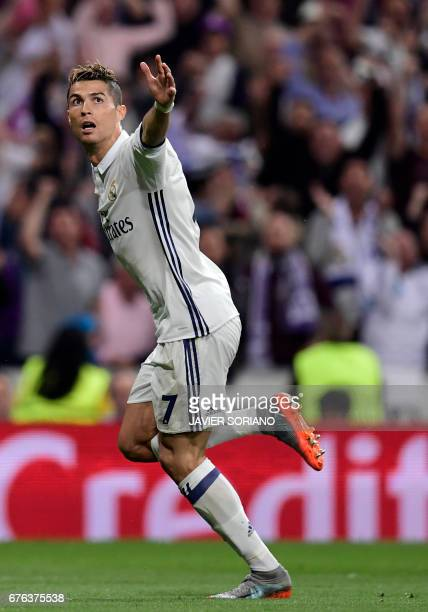 Real Madrid's Portuguese forward Cristiano Ronaldo celebrates his second goal during the UEFA Champions League semifinal first leg football match...