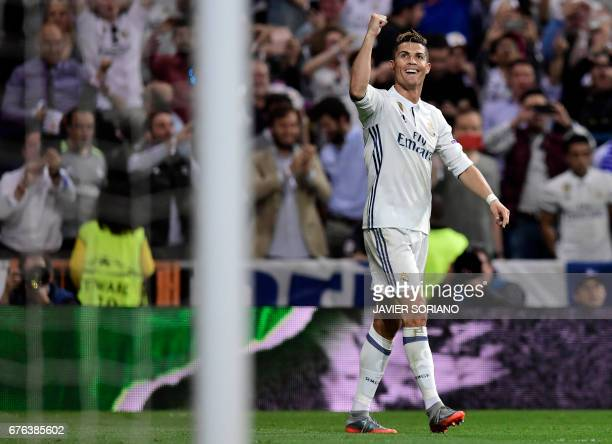 TOPSHOT Real Madrid's Portuguese forward Cristiano Ronaldo celebrates his third goal during the UEFA Champions League semifinal first leg football...