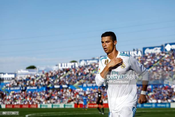 Real Madrid's Portuguese forward Cristiano Ronaldo celebrates his team's second goal during the Spanish league football match Getafe CF vs Real...