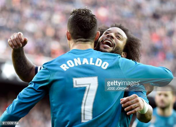 Real Madrid's Portuguese forward Cristiano Ronaldo celebrates his second goal with Real Madrid's Brazilian defender Marcelo during the Spanish league...