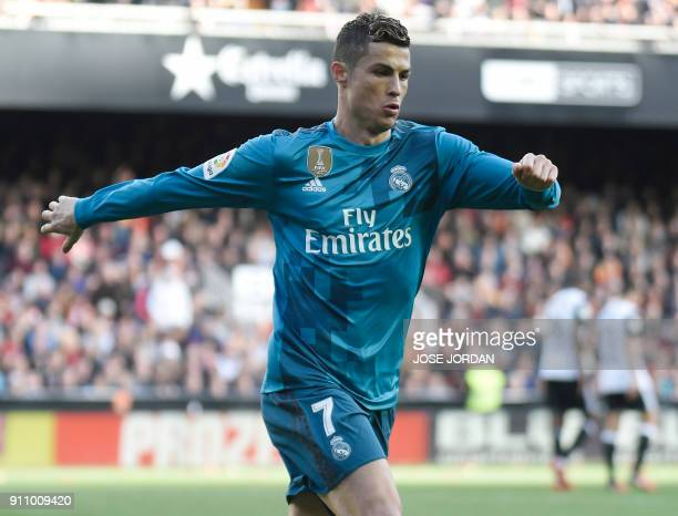Real Madrid's Portuguese forward Cristiano Ronaldo celebrates his second goal during the Spanish league football match between Valencia CF and Real...