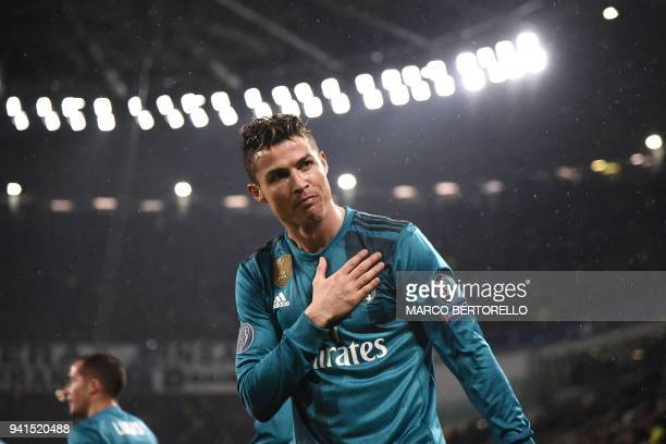 TOPSHOT Real Madrid's Portuguese forward Cristiano Ronaldo celebrates his second goal during the UEFA Champions League quarterfinal first leg...
