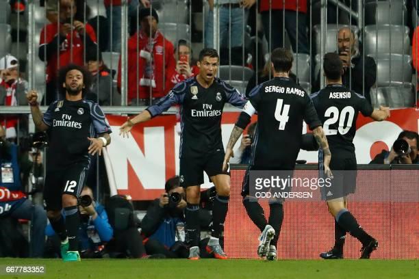 Real Madrid's Portuguese forward Cristiano Ronaldo celebrates scoring the 12 goal with his teammates during the UEFA Champions League 1st leg...