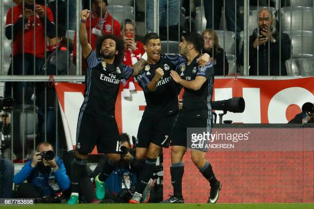 Real Madrid's Portuguese forward Cristiano Ronaldo celebrates scoring the 12 goal with his teammates during the UEFA Champions League 1st leg...