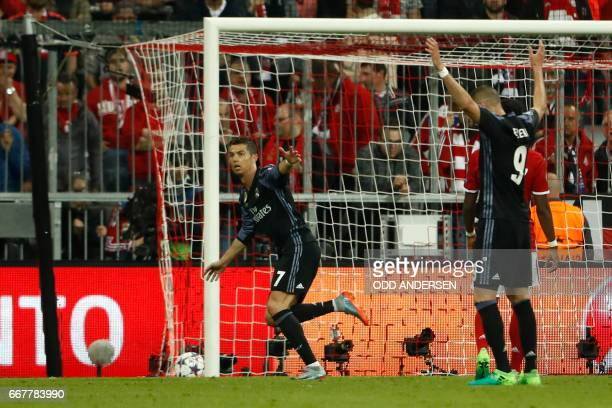 Real Madrid's Portuguese forward Cristiano Ronaldo celebrates scoring the 12 goal during the UEFA Champions League 1st leg quarterfinal football...