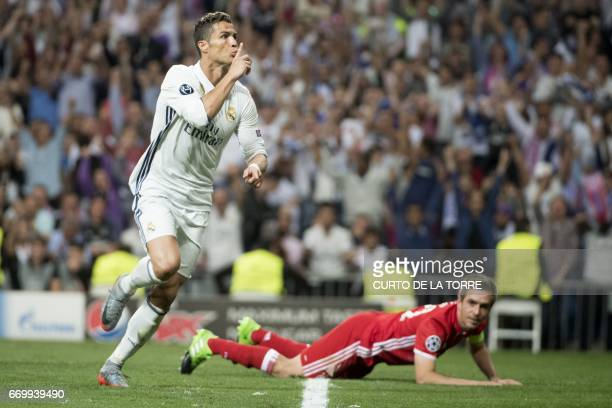 TOPSHOT Real Madrid's Portuguese forward Cristiano Ronaldo celebrates scoring during the UEFA Champions League quarterfinal second leg football match...