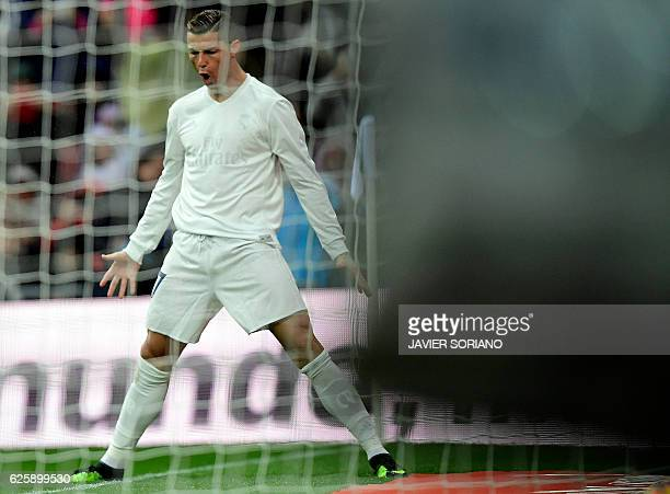 Real Madrid's Portuguese forward Cristiano Ronaldo celebrates the opening goal during the Spanish league football match Real Madrid CF vs Real...