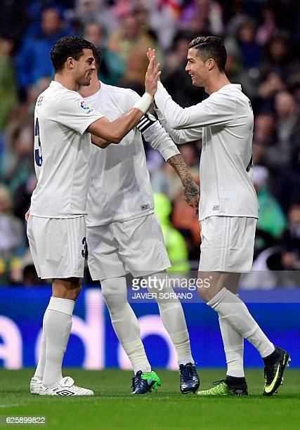 Real Madrid's Portuguese forward Cristiano Ronaldo celebrates the opening goal with teammate Real Madrid's Portuguese defender Pepe during the...