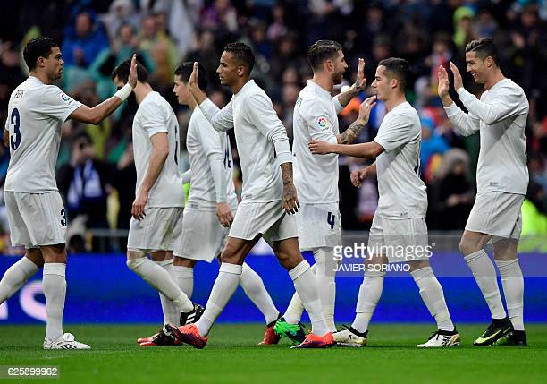 Real Madrid's Portuguese forward Cristiano Ronaldo celebrates the opening goal with teammates during the Spanish league football match Real Madrid CF...