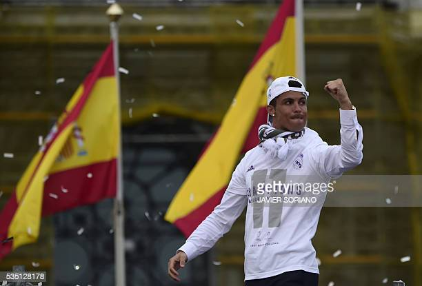 Real Madrid's Portuguese forward Cristiano Ronaldo celebrates the team's win on Plaza Cibeles in Madrid on May 29 2016 after the UEFA Champions...