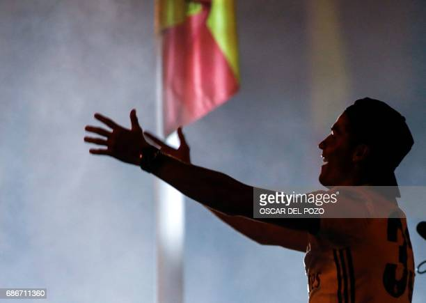 Real Madrid's Portuguese forward Cristiano Ronaldo celebrates the team's win on Plaza Cibeles in Madrid on May 22 2017 after the Spanish league...