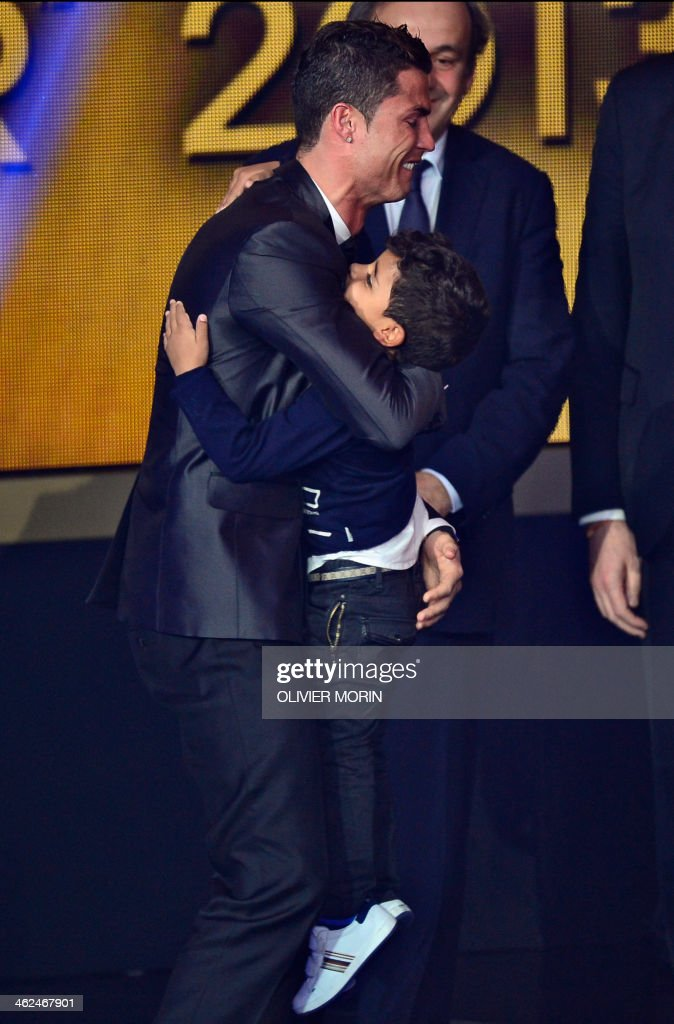 Real Madrid's Portuguese forward Cristiano Ronaldo celebrates with his son Cristiano Ronaldo Junior after receiving the 2013 FIFA Ballon d'Or award for player of the year during the FIFA Ballon d'Or award ceremony at the Kongresshaus in Zurich on January 13, 2014. AFP PHOTO / OLIVIER MORIN / AFP PHOTO / Olivier MORIN